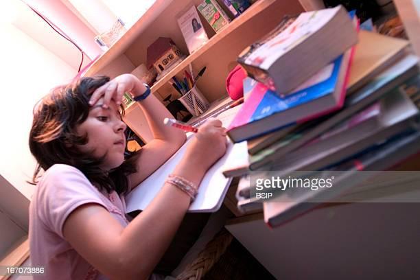 Child doing homework Model 10 year old girl