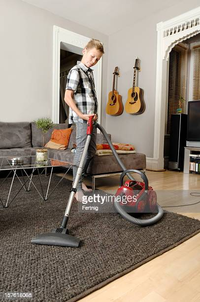 Child doing the vacuuming