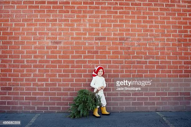 Child dragging christmas tree