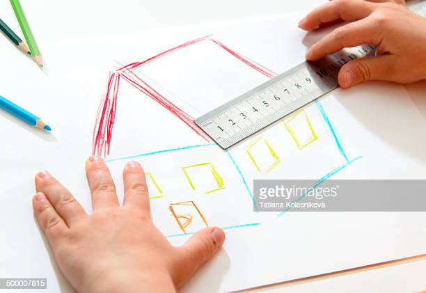 Child drawing a house
