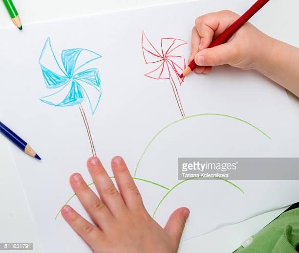 Child drawing windmills