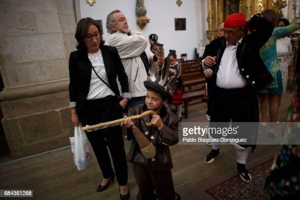 A child dressed as a Zarron plays with his stick during the Zarron festival on May 17 2017 in Almazan Soria province Spain El Zarron of Almazan...