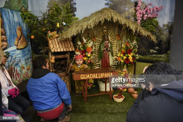 A child dressed as indigenous peasant Juan Diego plays marimba during the celebration of the apparition of the Virgin of Guadalupe to Juan Diego in...
