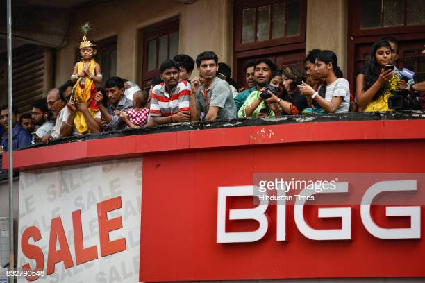 A child dressed as Lord Krishna during Dahi Handi celebrations at Dadar on August 15 2017 in Mumbai India The childgod Krishna and his friends used...