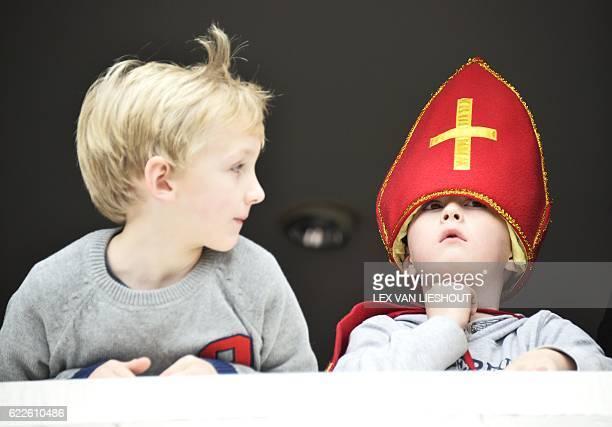 A child dressed as Sinterklaas looks on in Maassluis on Novermber 12 2016 / AFP / ANP / Lex van Lieshout / Netherlands OUT