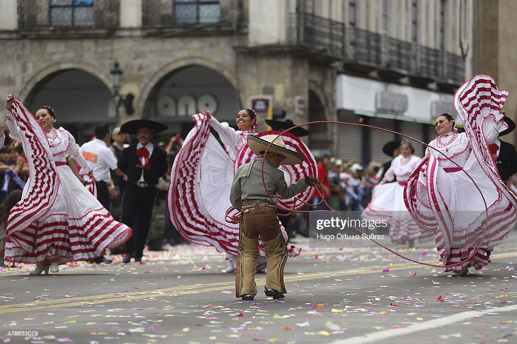 CONTENT] GUADALAJARA JALISCO MEXICO SEPTEMBER 01 A child dressed in Charro performs with a rope while participating in a parade commemorating the...