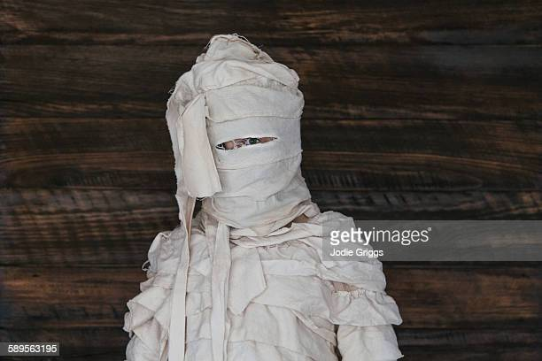 Child dressed in home made egyptian mummy costume
