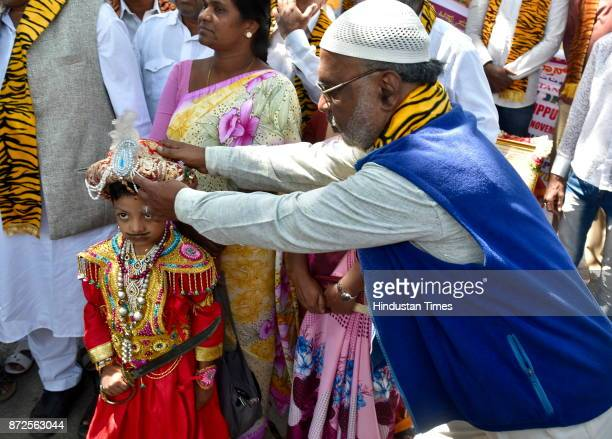 A child dressed like Tippu Sultan on his birth anniversary as Tippu Sultan United Front celebrates outside Tippu Sultan's summer palace on November...
