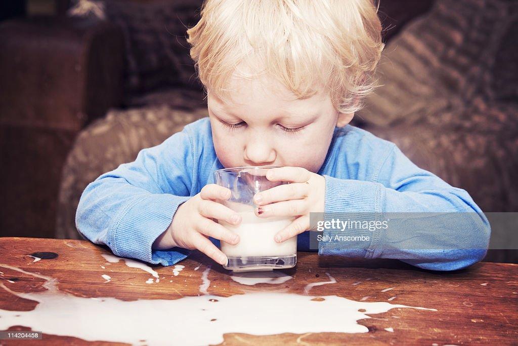 Child drinking milk : Stock Photo