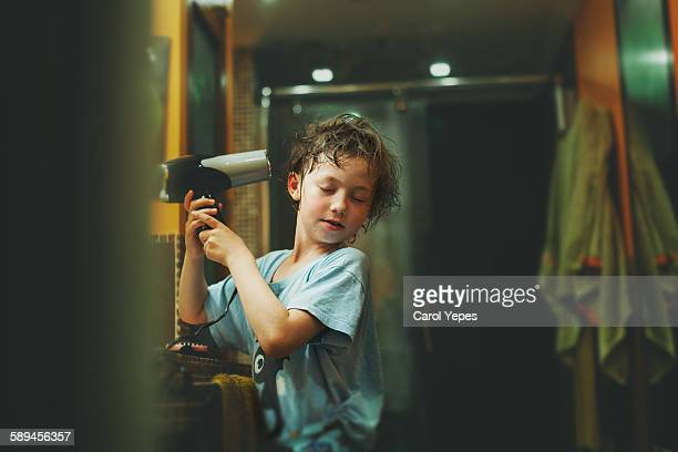 Child drying his hair