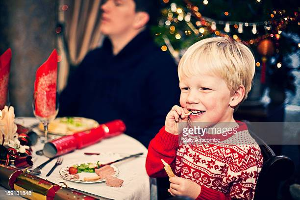 Child eating Christmas dinner.