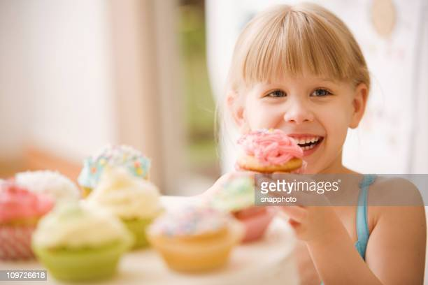 Child Eating Cupcakes