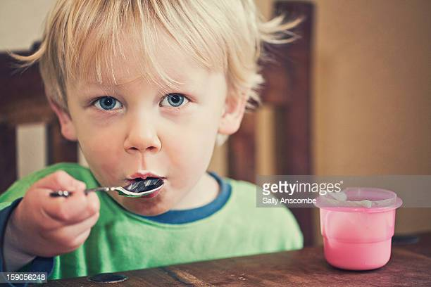 Child eating his breakfast