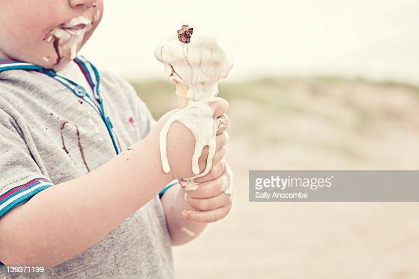 Child eating melted ice cream