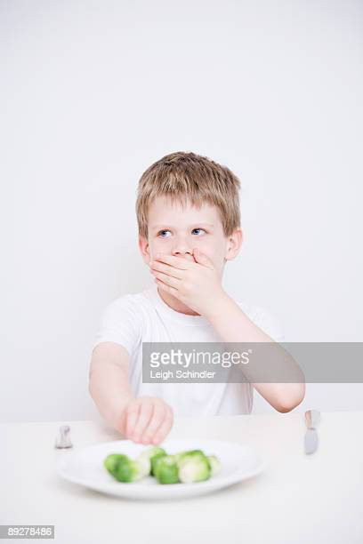 Child Eating Vegetables