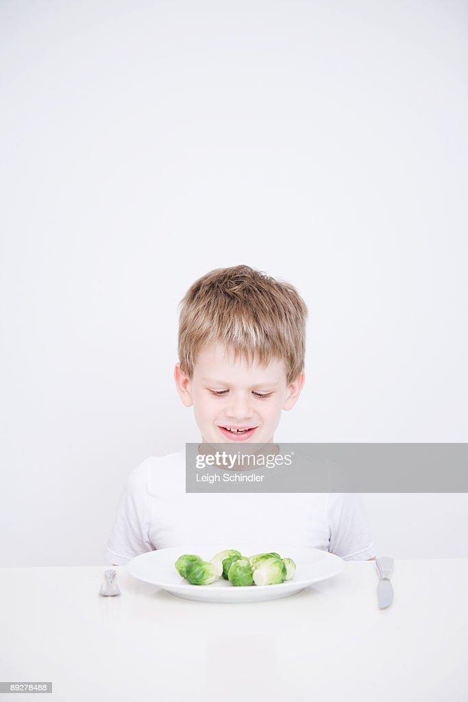 Child Eating Vegetables : Stock Photo
