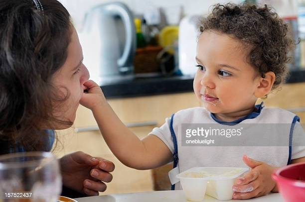 Child Eating Yoghurt with Her Mother, Horizontal