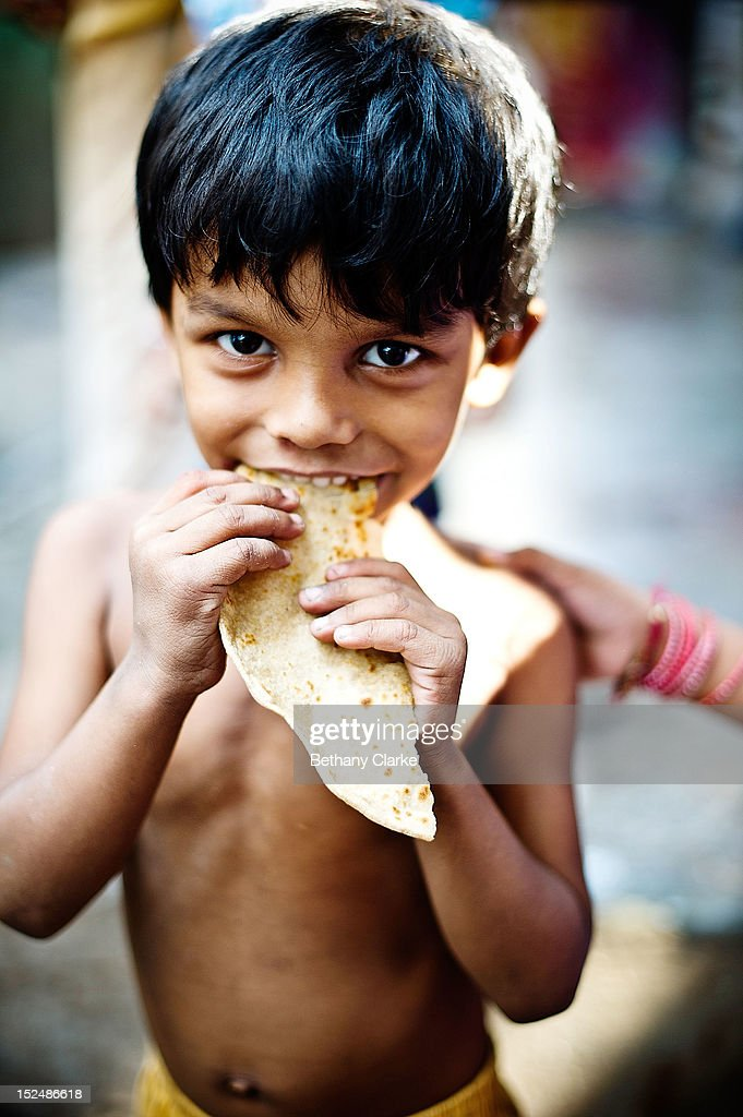 A child eats a chapatti in Dharavi November 4 2011 in Mumbai India Dharavi Asia's largest slum situated in the centre of Mumbai One million people...