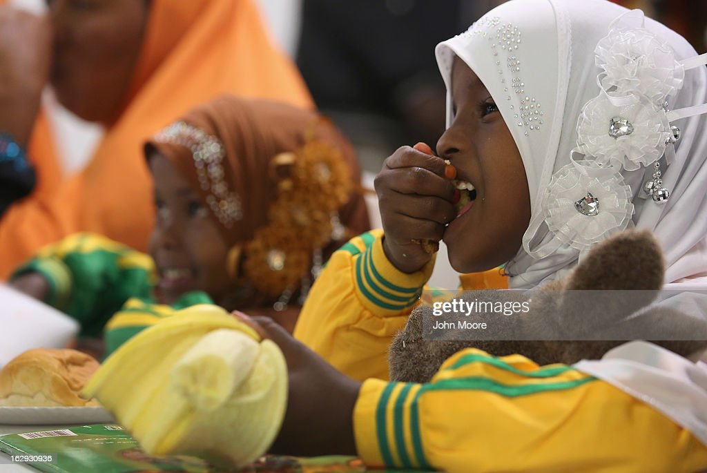 A child eats a snack as her parents, recently-arrived refugee from Somalia, learn how to receive food stamps during a class held by the Arizona Department of Economic Security at the International Rescue Committee (IRC), office on March 1, 2013 in Phoenix, Arizona. IRC programs, like many programs that receive federal funding, may be greatly cut back due to federal sequestration cuts. The IRC is a non-profit humanitarian aid organization that aids refugees and survivors of international conflict. They assist new arrivals, many of whom come from refugee camps and war zones, to adjust to American society after being granted refugee status and invited by the U.S. government to live in the United States. The IRC also assists refugees through the immigration and naturalization process to become U.S. citizens.