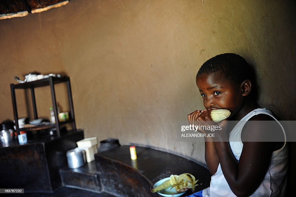 A child eats maize in her home in Domboshava 60km north of Harare on March 15, 2013 a day before people in Zimbabwe go to the polls to vote in a constitutional referendum that would guarantee democracy in future elections in the crisis-weary country. If approved, the new supreme law will also clip many of the presidential powers that veteran leader Robert Mugabe has enjoyed for decades. The constitution looks poised to be easily adopted, laying the groundwork for watershed general elections that would end an often acrimonious power-sharing deal between Mugabe and his nemesis Morgan Tsvangirai. JOE