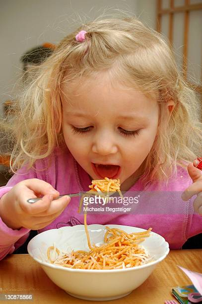 Child eats spaghetti