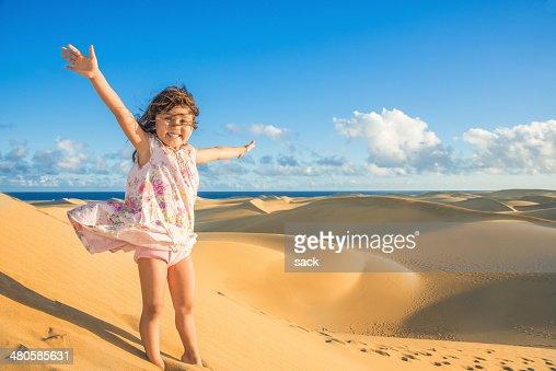 Child enjoying dunes (Maspalomas Gran Canaria)