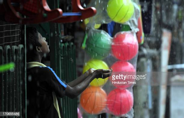 Child enjoying during premonsoon rain on June 16 2013 in Noida India The national capital has been witnessing premonsoon showers recording 61 mm of...