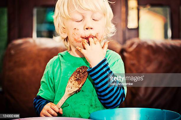 Child enjoying eating chocolate