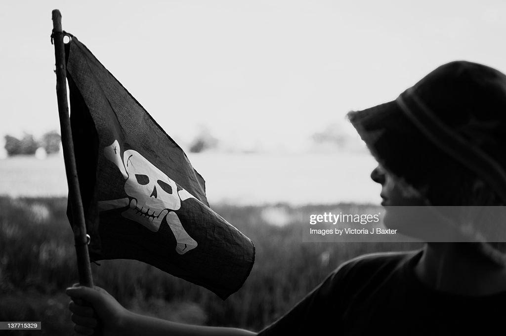 Child enjoying imaginative pirate play : Stock Photo