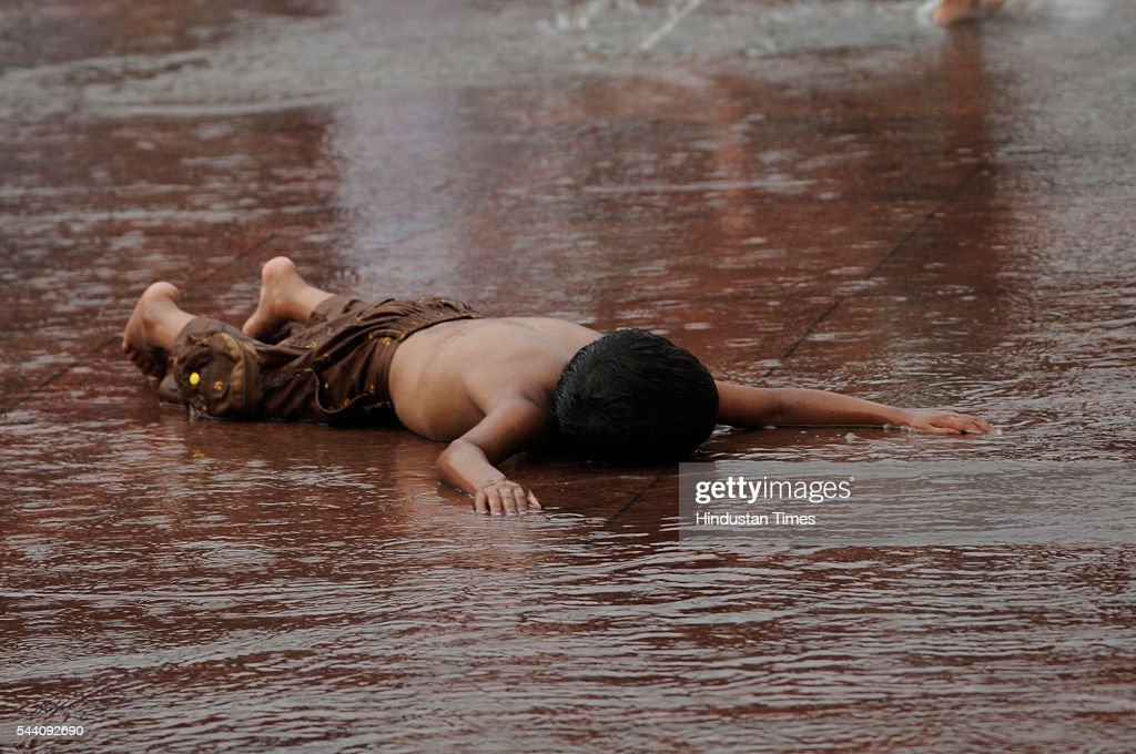 A child enjoying rain near Jama Masjid on July 1, 2016 in New Delhi, India. The capital received its first Monsoon rains dragging the maximum temperatures several notches below normal. Heavy downpour caused water logging and traffic jams in the city.