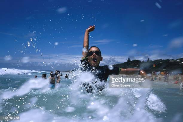 Child enjoying water on Sunshine Beach.