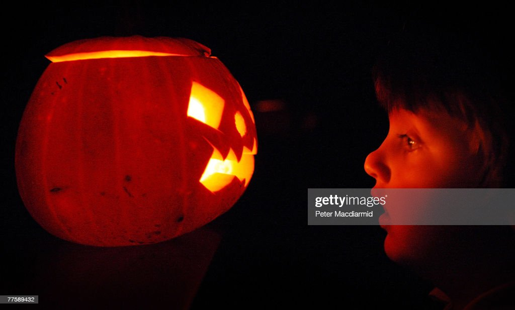 A child enjoys traditional candlelit Halloween pumpkins on October 31 2007 in London