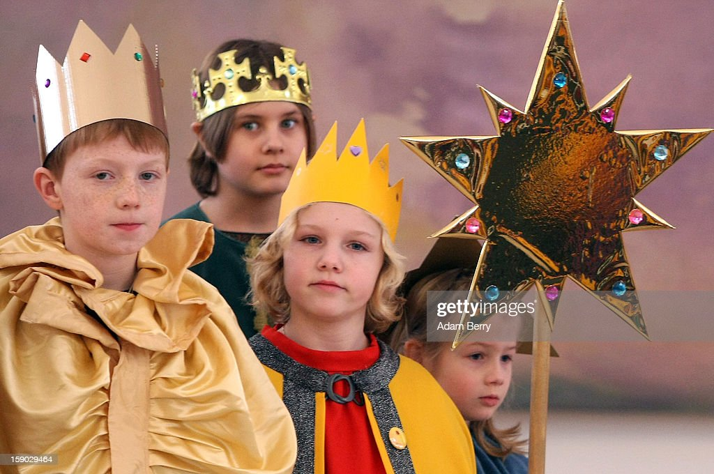 Child Epiphany carolers known as Sternsinger in German visit German President Joachim Gauck at Bellevue presidential palace on January 6 2013 in...
