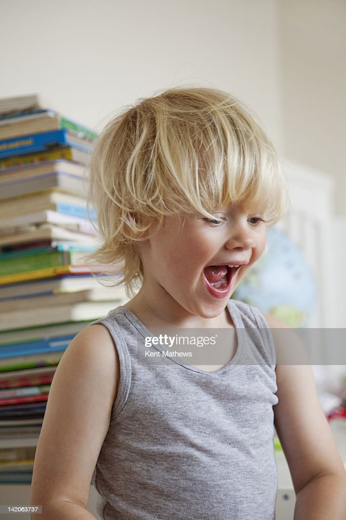 child excited with mouth open. : Stock Photo