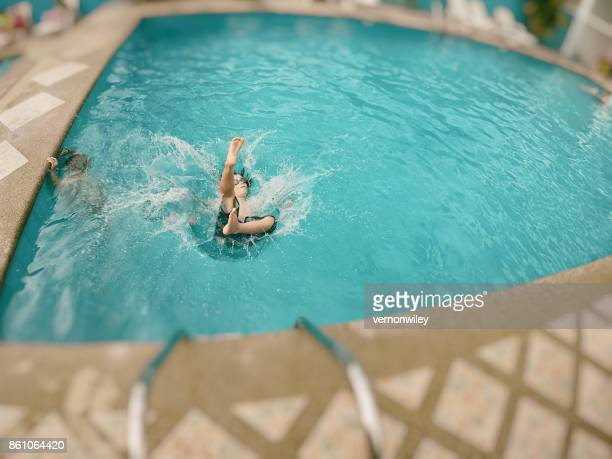 Child falling into a pool of water