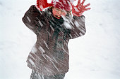 Child fighting a snowstorm