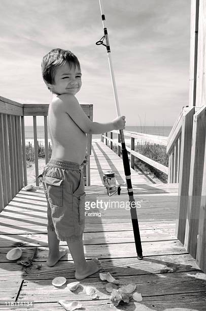 Child fisherman heading to the seaside