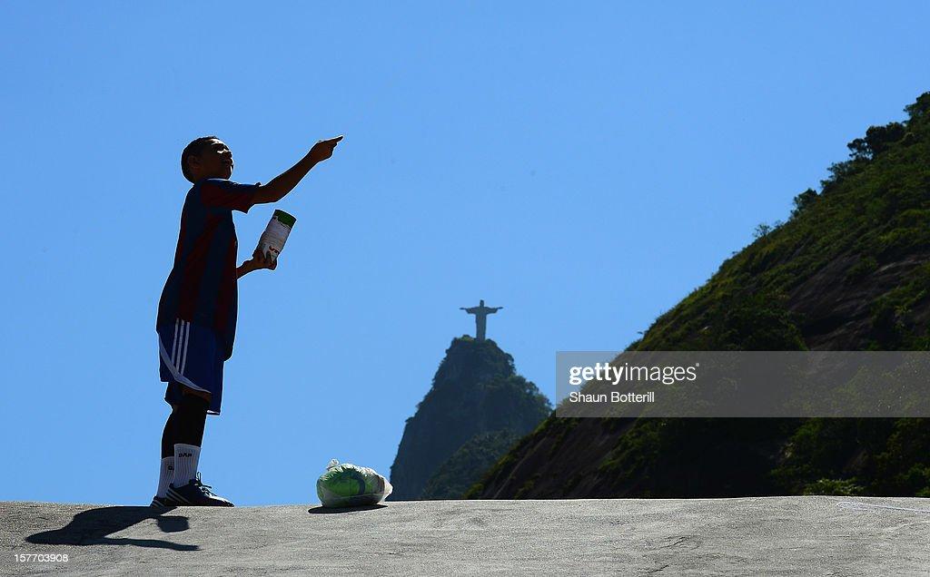 A child flies a kite in Santa Marta Favela on December 5, 2012 in Rio de Janeiro, Brazil.