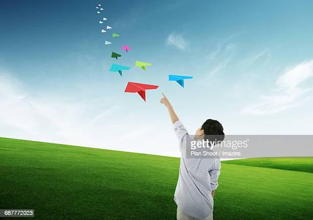 Child flying paper plane