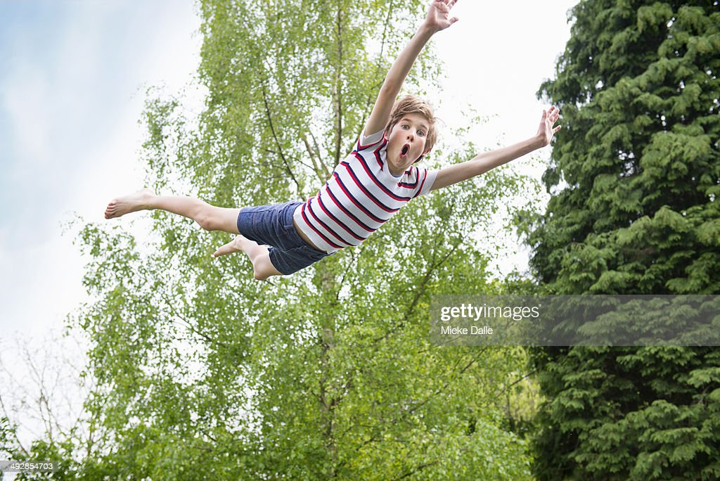 Child flying through the air : Stock Photo