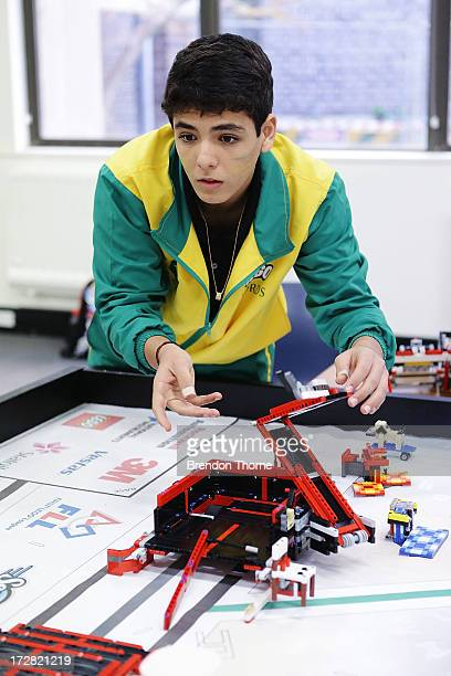 A child from Brazil operates his robot at the LEGO Education FIRST Robot Games Tournament on July 5 2013 in Sydney Australia Over 50 teams 550...