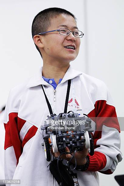 A child from China holds his robot at the LEGO Education FIRST Robot Games Tournament on July 5 2013 in Sydney Australia Over 50 teams 550 children...