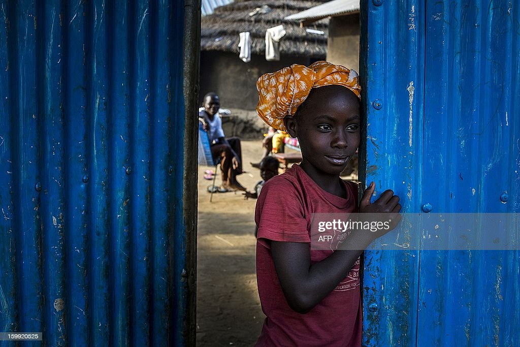 A child from South Sudan's Bari tribe stands at the entrance into a compound near Gudele market in Juba, South Sudan January 23, 2012. Gudele was the scene of last year's (December 18) murder of writer Isaiah Abraham, an outspoken critic of the government whose death has raised concerns over press freedom in the fledgling nation, according to US embassy officials. Relatives say Diing Chan Awuol, who wrote under the pen name of Isaiah Abraham, was shot dead earlier this month for outspoken comments that included calling for an improvement in relations with former enemies in Khartoum. AFP PHOTO/ Camille Lepage