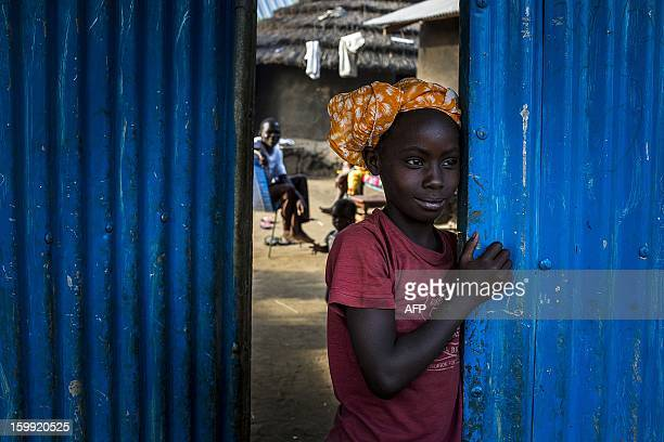 A child from South Sudan's Bari tribe stands at the entrance into a compound near Gudele market in Juba South Sudan January 23 2012 Gudele was the...