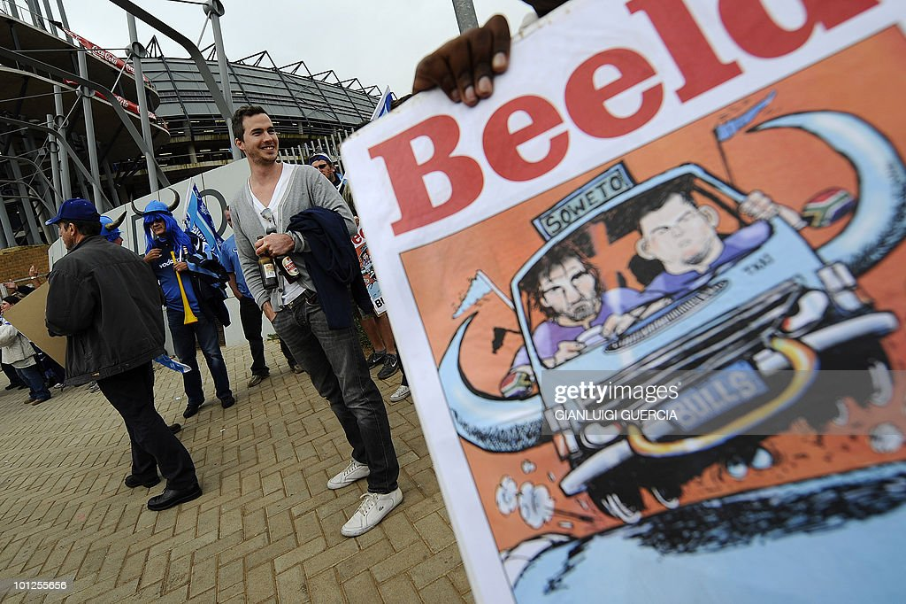 A child from Soweto holds a placard as Bulls supporters gather outside Orlando stadium ahead of the Super14 Final match between Bulls and Stormers in Johannesburg, on May 29, 2010.
