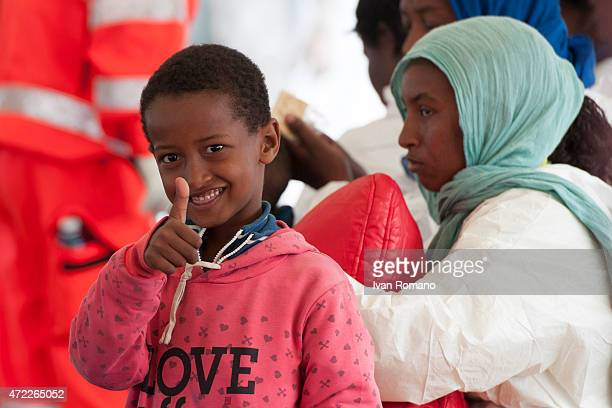 A child gestures after disembarking from military ship 'Bettica' following a rescue operation at sea on May 5 2015 in the port of Salerno southern...