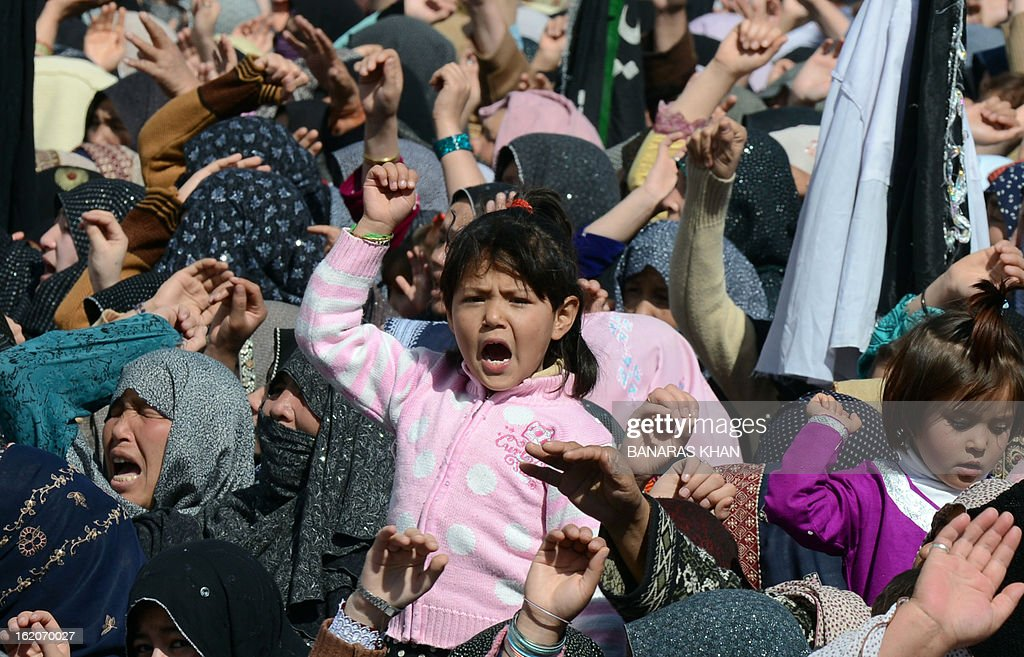 A child gestures as Pakistani Shiite Muslim women demonstrate on the third day of protests following Saturday's bombing in Quetta on February 19, 2013, against the bombing targeted Shiite Muslims. Pakistani forces on Tuesday killed four men and arrested seven others accused of killing Shiite Muslims, including an alleged mastermind of a bomb attack that killed 89 people, officials said. AFP PHOTO/Banaras KHAN