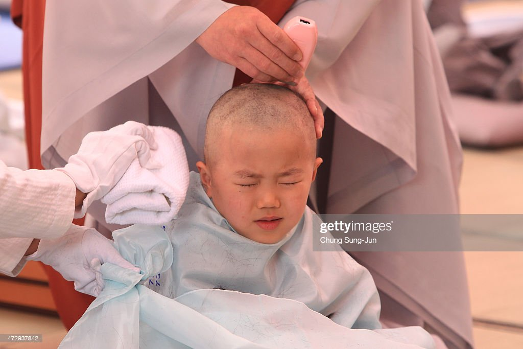 A child gets his head shaved by a Buddhist monk during the 'Children Becoming Buddhist Monks' ceremony forthcoming buddha's birthday at a Chogye temple on May 11, 2015 in Seoul, South Korea. Children have their hair shaved off during the 'Children Becoming Buddhist Monks' ceremony ahead of buddha's birthday at a Chogye temple. The children will stay at the temple to learn about Buddhism for 14 days. Buddha was born approximately 2,559 years ago, and although the exact date is unknown, Buddha's official birthday is celebrated on the full moon in May in South Korea, which is on May 25 this year.