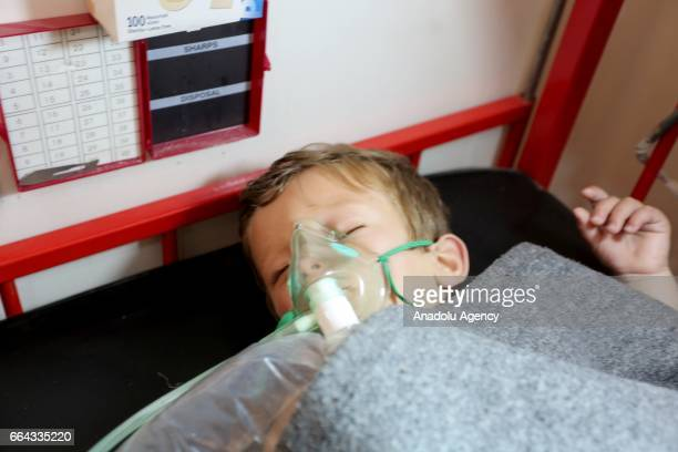 A child gets treatment at a hospital after a suspected chlorine gas attack by Assad Regime forces to Khan Shaykhun town of Idlib Syria on April 4 2017