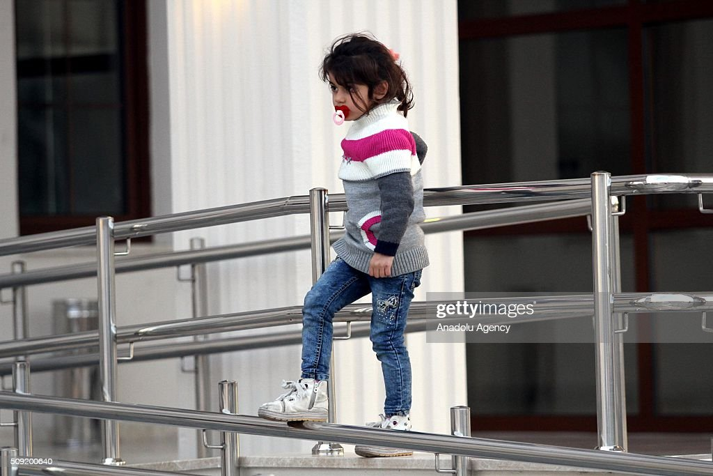 A child girl is seen as Refugees wait outside the Fethiye District Police Department Directorate after Turkey 122 refugees were captured in the Aegean Sea on February 9, 2016. Total of 122 refugees were captured by Turkish coast guards while they were illegally trying to reach Greece's Rhodes island through the Aegean Sea.